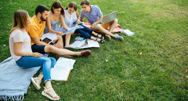 https://www.freepik.com/free-photo/group-of-cheerful-students-teenagers-in-casual-outfits-with-note-books-and-laptop_2583684.htm